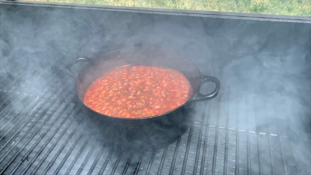 dutch oven of baked beans on the smoker