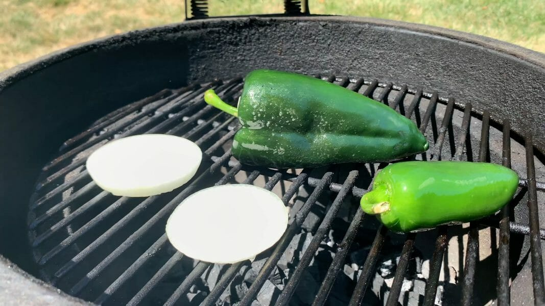 roasting peppers and onions on the grill