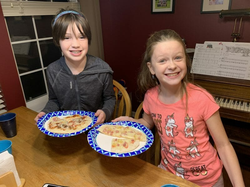 kids enjoying their grilled pizza creations