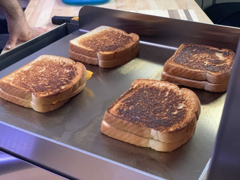 grilled cheese sandwiches cooking on the wee griddle