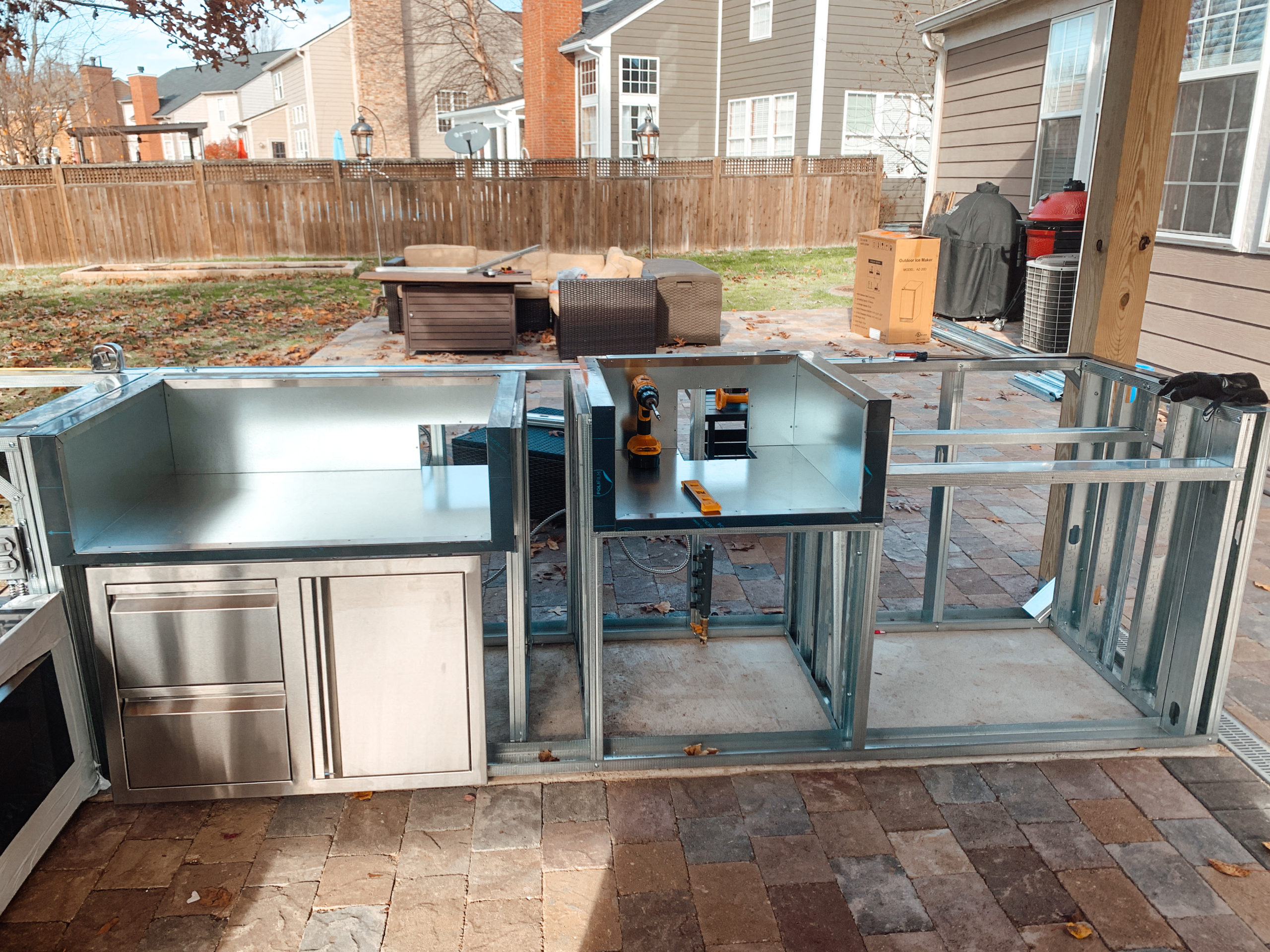 metal framing of outdoor kitchen with space for American Renaissance gas grill on the left