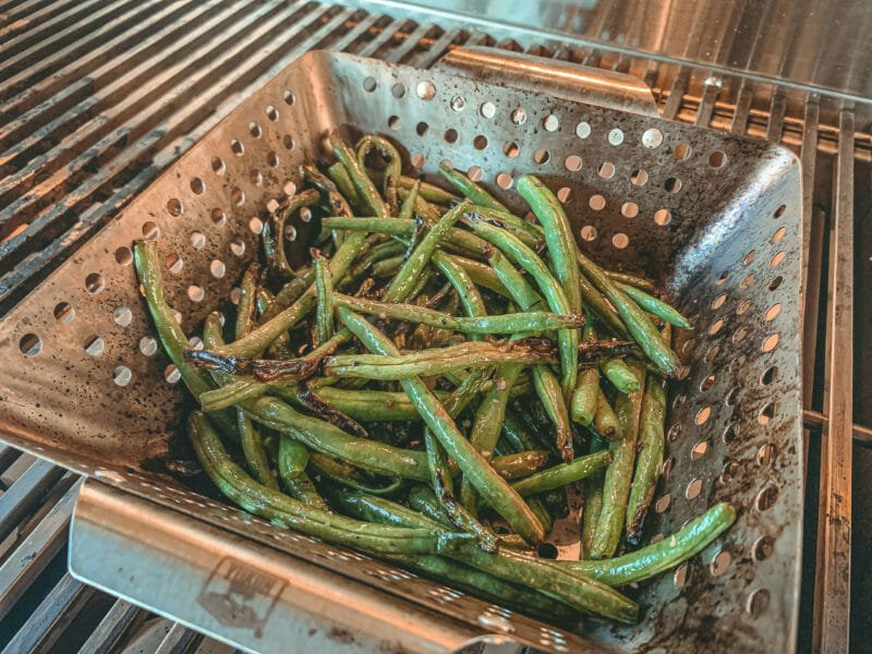 green beans cooking in a grill basket on the ARG36