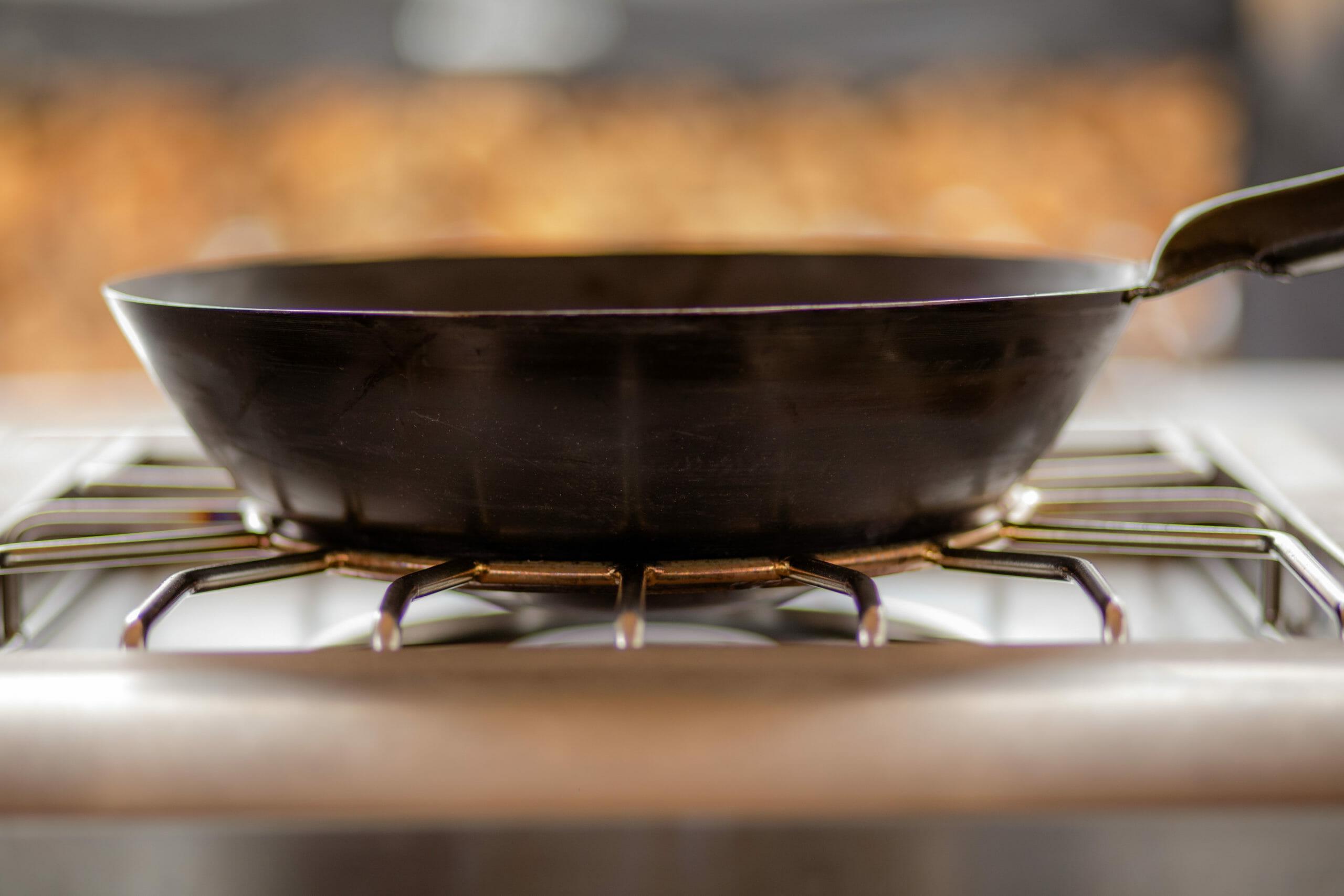 wok sitting on the American Renaissance Grill Pro Burner