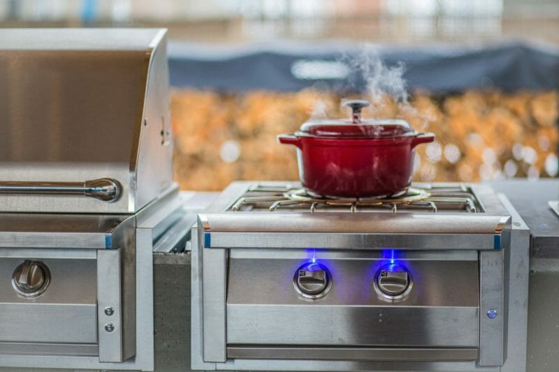 American Renaissance Grill Pro Burner cooking a pot of pork chili verde