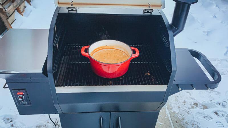 pot of white chicken chili smoking on Z Grills 1000E