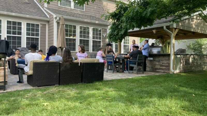 family BBQ in the outdoor kitchen