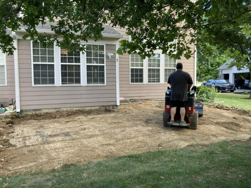 David digging the base of the patio with a skid steer