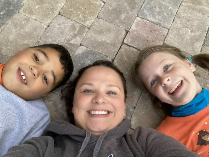 Melissa and the kids celebrating a small section of pavers