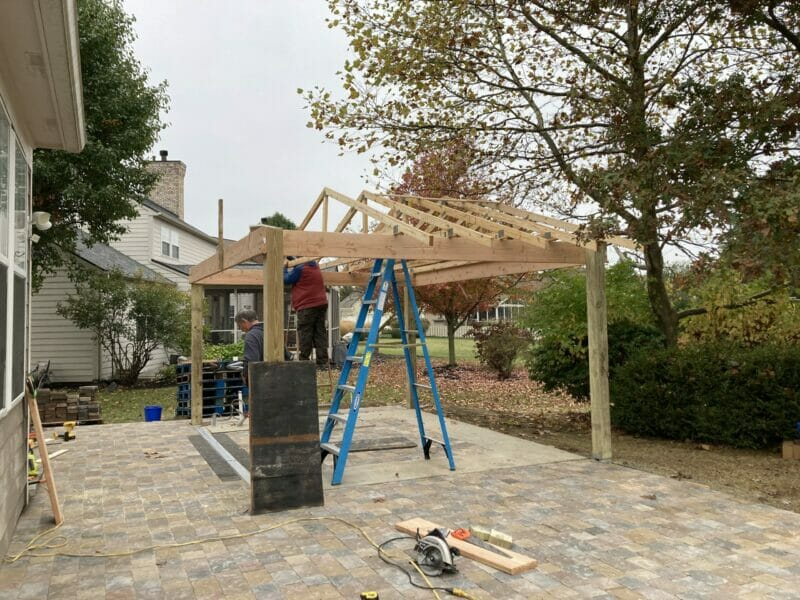 David and Dad putting up the trusses