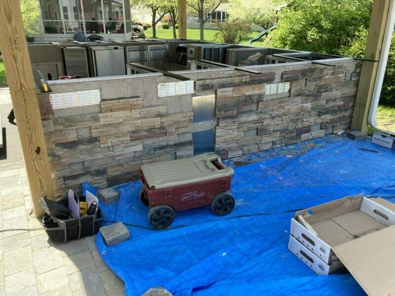 outdoor kitchen construction with stone veneer