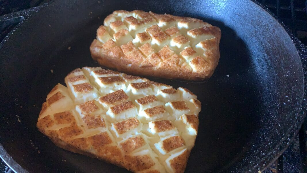 sweet and savory smoked cream cheese in a cast iron pan