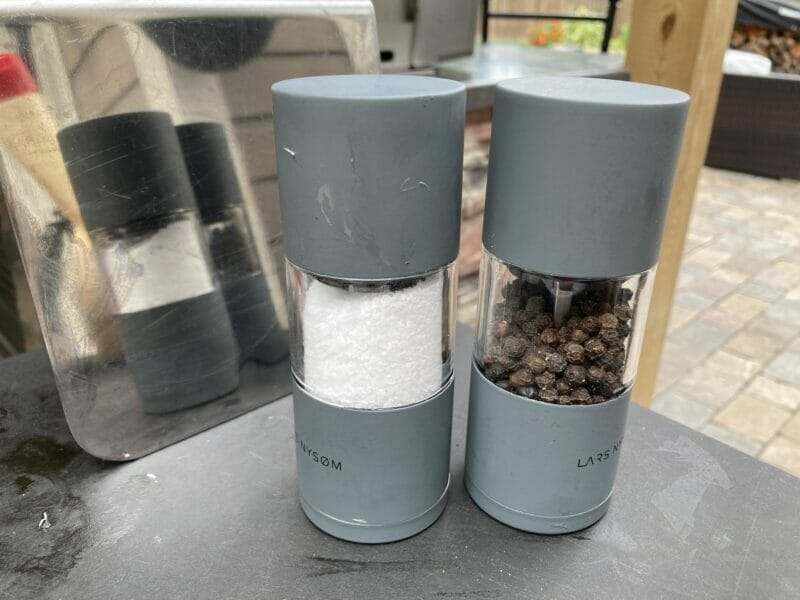 salt and pepper mills waiting to season the burgers